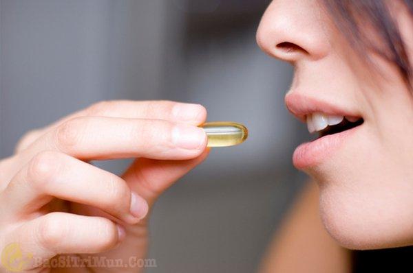 Uống vitamin E trị sẹo thâm mụn